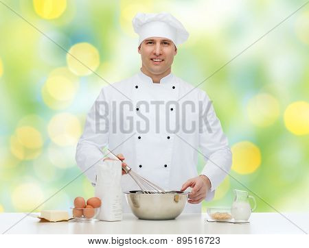 cooking, profession, haute cuisine, food and people concept - happy male chef cook baking over green lights background
