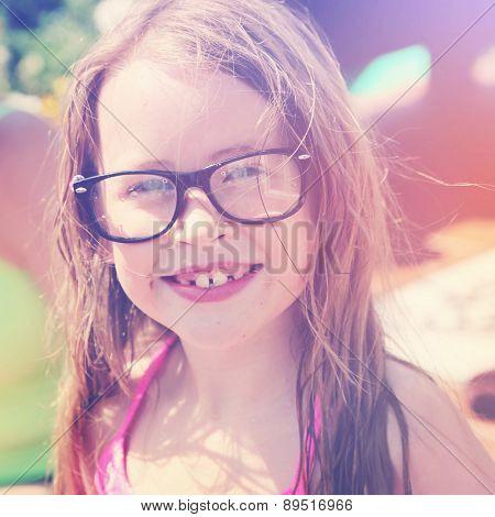 Little girl with nerd glasses on - instagram effect