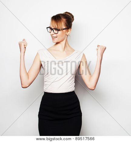 Business, finance and people concept: successful business woman with arms up