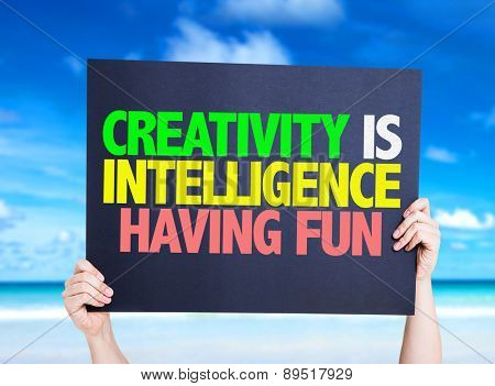 Creativity is Intelligence Having Fun card with beach background