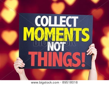 Collect Moments Not Things card with heart bokeh background