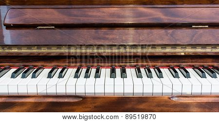 Wooden Piano And White Keys