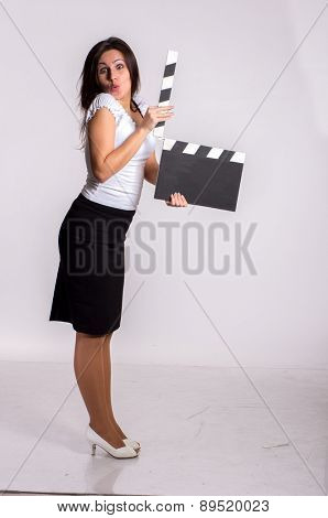 Studio shot of pretty yooun woman with clapboard
