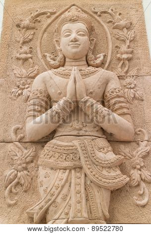 stone carving for greeting and smile deva statue