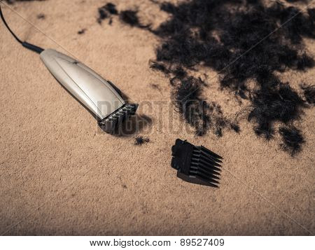 Hair Clippers Surrounded By Hair