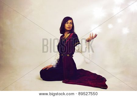 Beautiful Young Woman Posing In Historical Dress Making A Dramatic Gesture