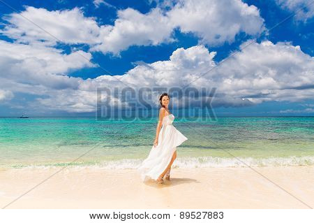 Happy Beautiful Fiancee In White Wedding Dress On Shore Sea. Wedding And Honeymoon In The Tropics.