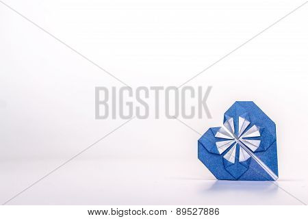 Photo of blue origami heart isolated on white background