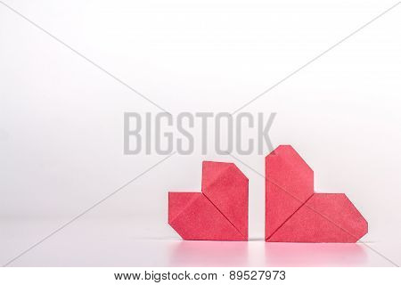 Photo of two red origami hearts. isolated on white background