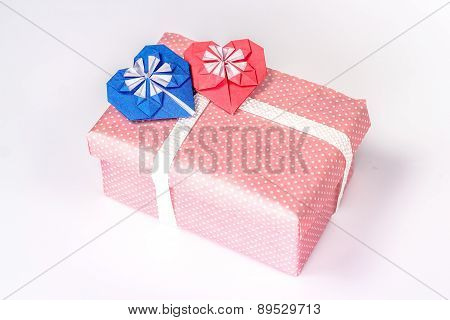 valentines gift box with red paper hearts. isolated on white background.