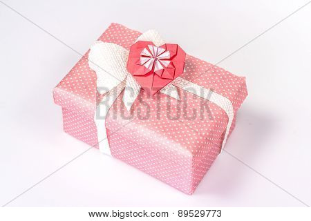 pink gift box with red origami paper heart.