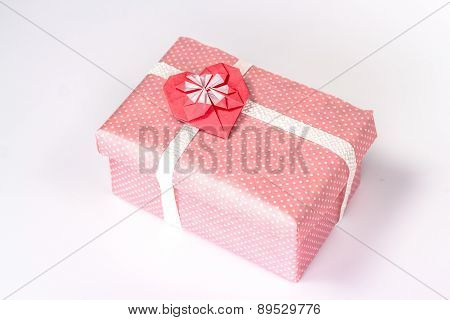 pink gift box with origami red heart.