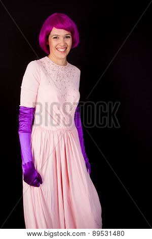 Portrait Of Beautiful Young Girl With Fancy Bright Make-up And Violet Wig