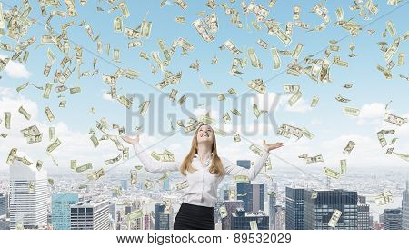 Beautiful Blonde Business Woman Is Happy About Falling Dollar Notes From The Sky. New York City Back