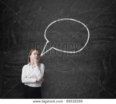 Young Blonde Business Woman And An Empty Thought Bubble On The Chalk Wall.