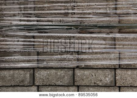 Pack of concrete blocks for pavement wrapped with cellophane in Prague, Czech Republic.