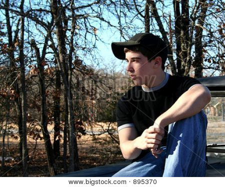 Teenage Boy Relaxing In The Woods