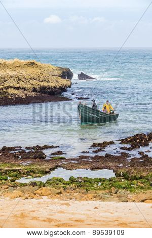OUALIDIA, MOROCCO, APRIL 6, 2015: Fishermen come back from sea in fishing boat