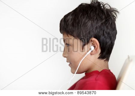 Profile of young boy with earphones