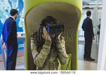 Woman With Virtual Reality Headset At Expo 2015 In Milan, Italy