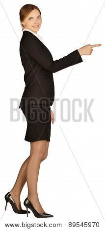 Business woman shows forefinger forward. white background