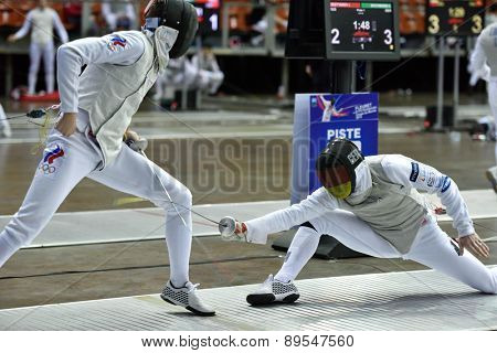 ST. PETERSBURG, RUSSIA - MAY 1, 2015: Ilya Degtyarev of Russia vs Sebastian Bachmann of Germany in International fencing tournament St. Petersburg Foil. The tournament is the stage of FIE World Cup
