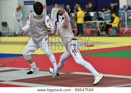 ST. PETERSBURG, RUSSIA - MAY 1, 2015: Xiaolong Wu of China (left) vs Nicholas Edward Choi of Hong Kong in International fencing tournament St. Petersburg Foil. The tournament is the stage of World Cup