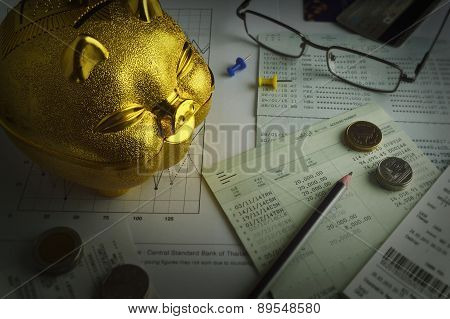 Gold Piggy Bank, Coin And Pencil On Saving Account Book