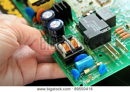 Technician With A Circuit Board