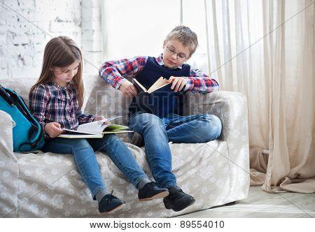 Children Readind Book In Living Room