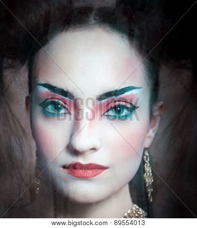 Close Up Stylized Portrait Of A Japanese Geisha With Bright Make Up