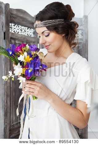 Beautiful Bride With Colorful Wedding Bouquet In Her Hands