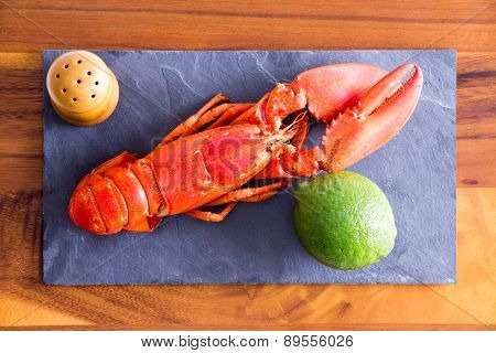 Cooked Red Lobster On A Board With Lime And Salt