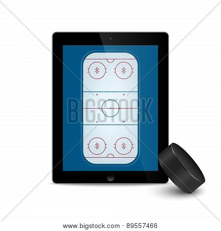 Black Tablet With Ice Hockey Puck And Field On The Screen.