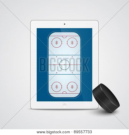 White Tablet With Ice Hockey Puck And Field On The Screen.