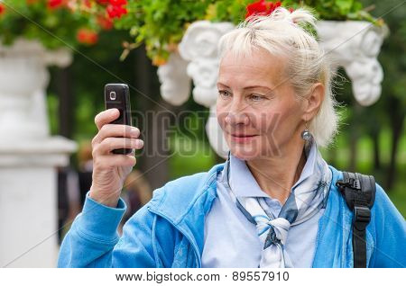 Woman Photographed In A Park On The Phone