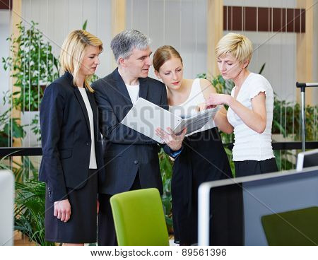 Business team with man and women doing teamwork in office
