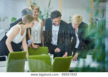 Successful business team doing planning in office meeting