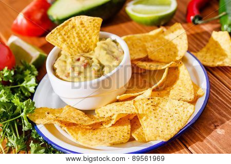 Guacamole with avocado, lime, tomato, and cilantro