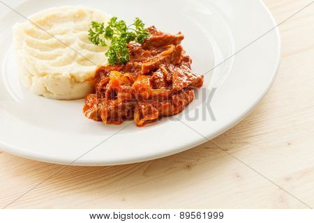 Beef stew with mashed potatoes