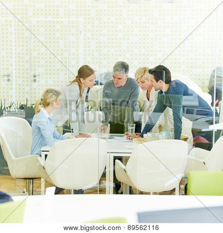 Meeting of consulting team in conference room of office