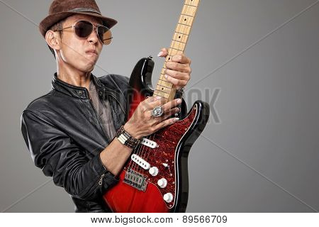 Young rock guitarist  playing solo