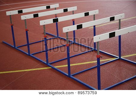 Hurdles On The Red Running Track Indoor