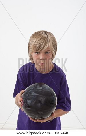 Young boy with bowling ball