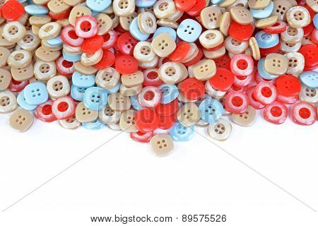 Pile of colorful plastic buttons