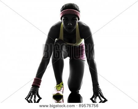 one  woman runner running on starting blocks in silhouette on white background