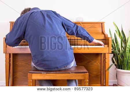 Enthusiastic Man Playing The Piano With Gusto