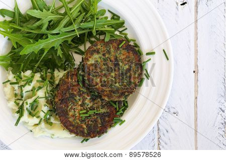 Swiss Chard Veggie Fritters With Mash Potatoes And Rocket Leaves