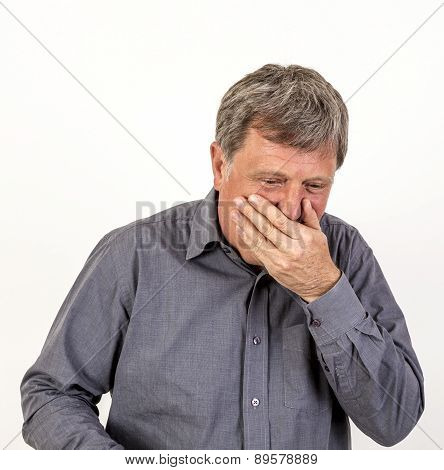 Coughing Mature Man With Grey Polo Shirt
