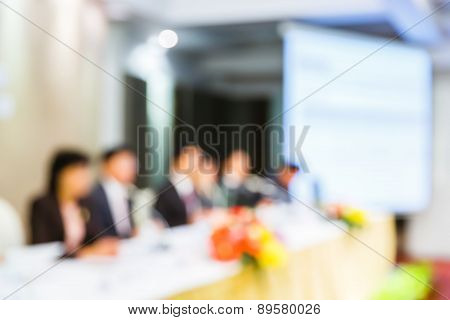 Blurred People In Seminar Room